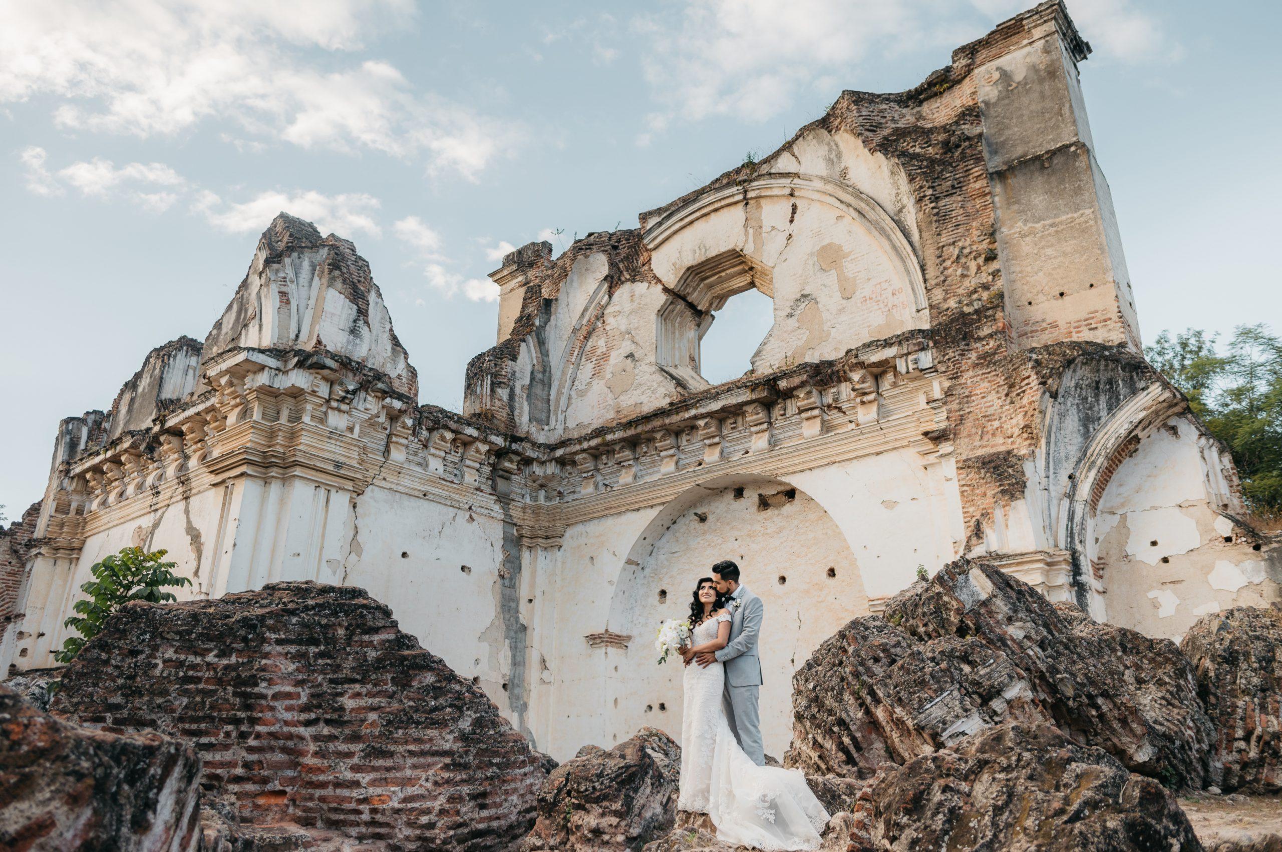 Couple hugging in the ruins of La Recoleccion in Antigua Guatemala