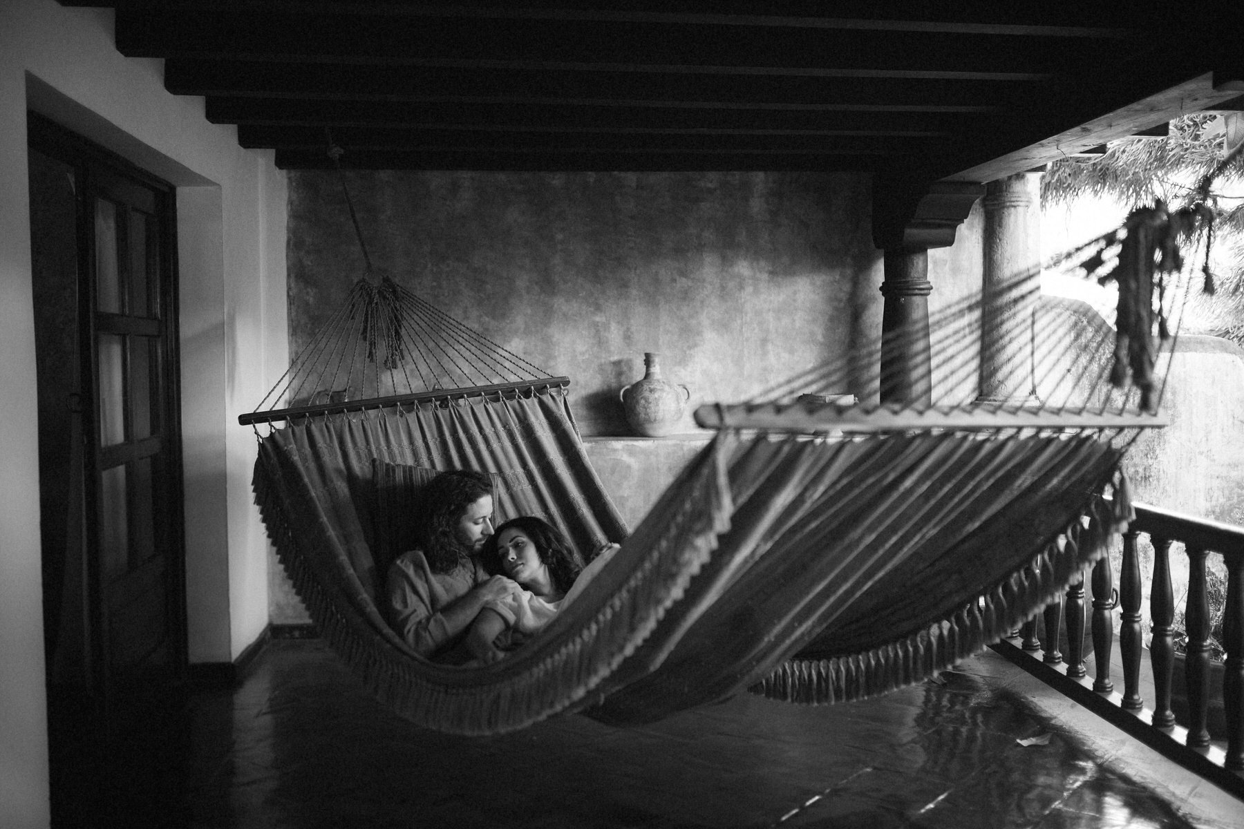 Couple in hammock at Meson Panza Verde Antigua