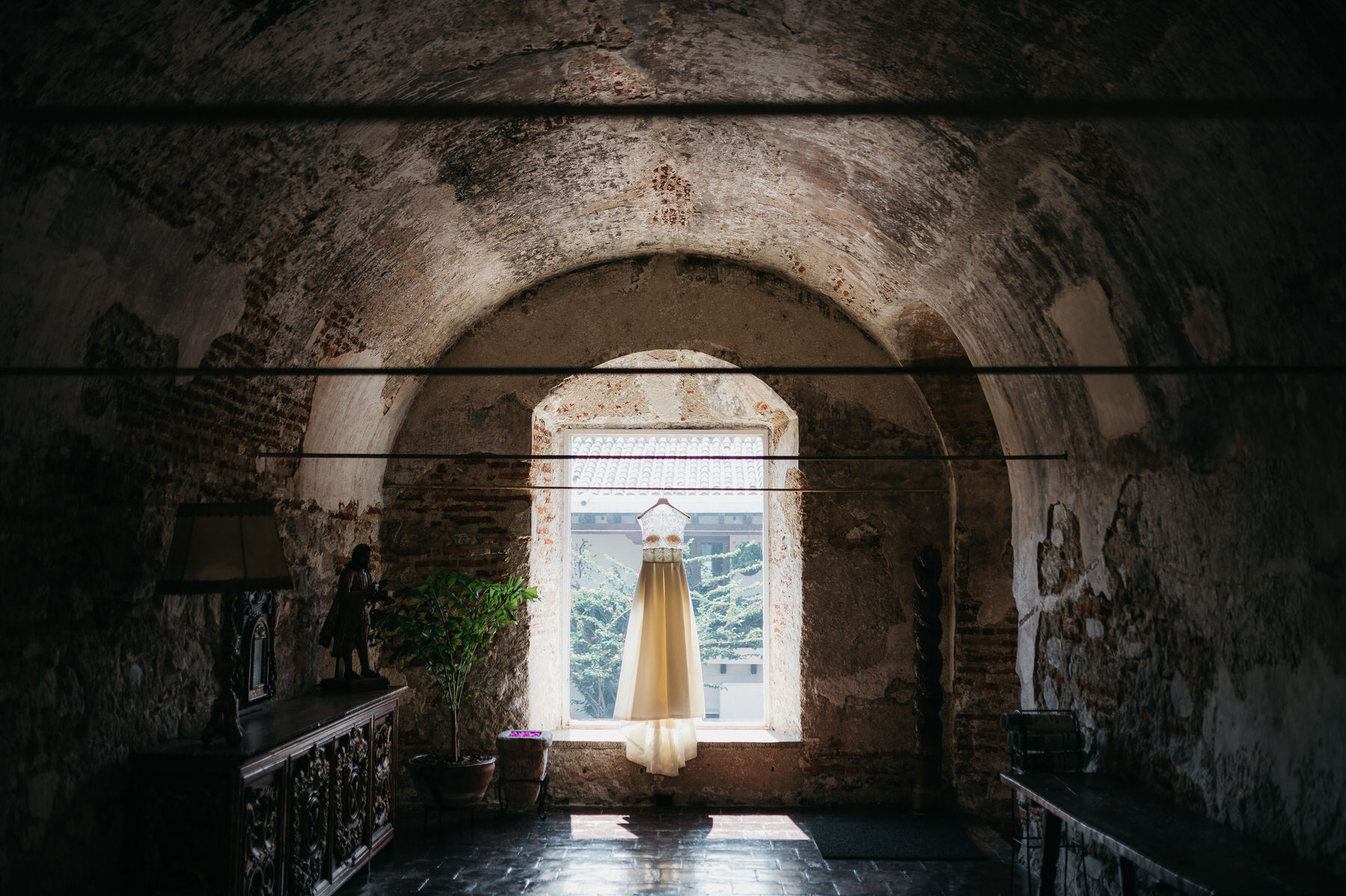 Wedding Dress Hangs at Hotel Casa Santo Domingo in Antigua Guatemala